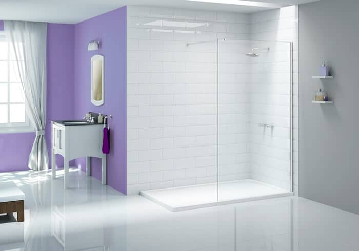 Purple painted wall adjacent to corner enclosed shower area