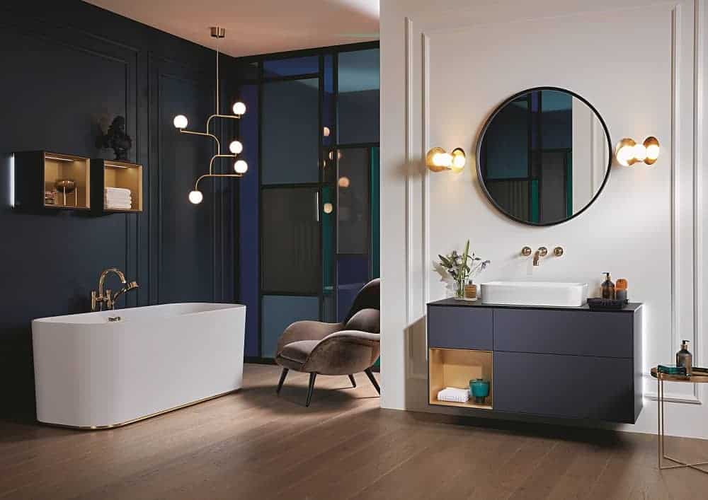 new bathroom with free standing bath, circular mirror and fine laminate flooring