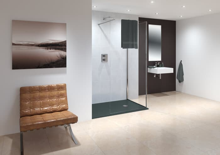 bare bathroom including leather chair, sink and small walk-in shower box