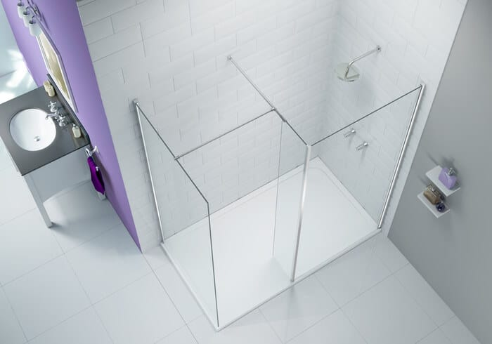 Bright new walk-in shower enclosures with dividing glass walls and soap dispensers