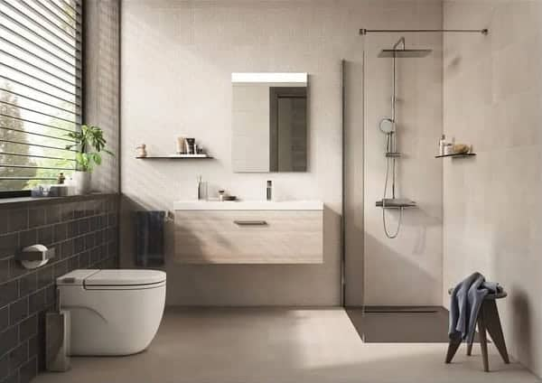 Beige bathroom flooring and tiles with corner walk-in shower