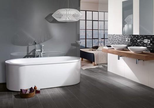 New bathroom renovation including free standing bath, grey tiled floor and matt grey walls