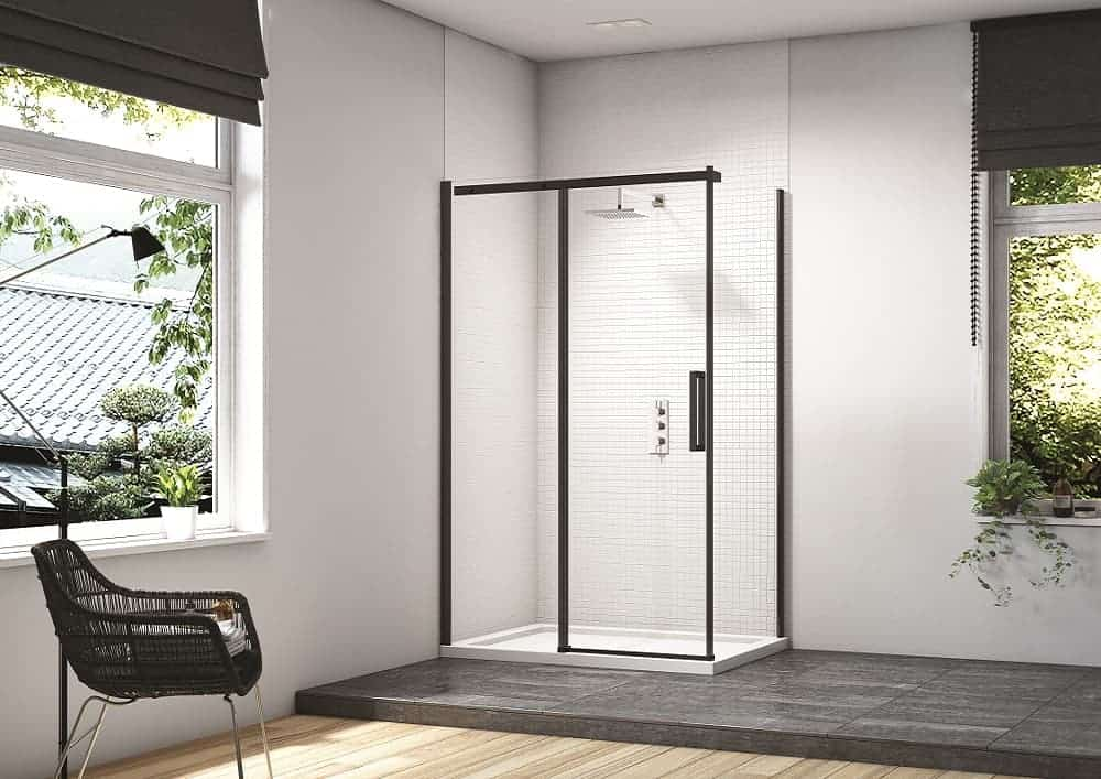 White and dark grey bathroom with free standing shower